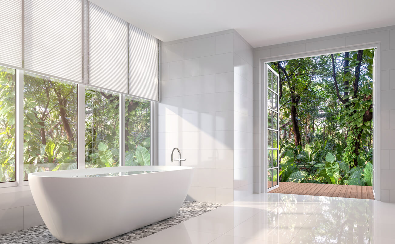 Modern white bath room 3d render. There are white tile wall and floor.The room has large open door looking out to the tropical garden.